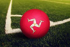 Isle Of Man ball on corner kick position, soccer field background. National football theme on green grass royalty free stock photos
