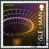 ISLE OF MAN - 2016: shows Black Hole, 100 Years of General Relativity. ISLE OF MAN - CIRCA 2016: A stamp printed in Isle of Man shows Black Hole, 100 Years of stock photos