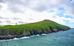 Isle of Man coastline landscape, Douglas, Isle of Man. Isle of Man coastline landscape, hills and mountain covered with green grass, Douglas, Isle of Man Royalty Free Stock Image