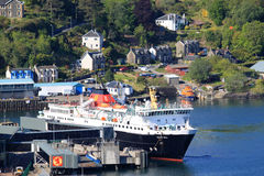Isle of Mull ferry in Oban harbour, Scotland. Looking down from McCaigs tower (folly) in Oban to the Caledonian Macbrayne ferry - Isle of Mull - docking in Oban Royalty Free Stock Photos
