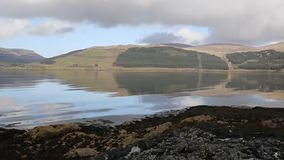 Isle of Mull Scotland UK beautiful Loch Scridain with view to Ben More and Glen More mountains pan stock video