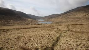 Isle of Mull Scotland UK beautiful loch and valley or glen pan stock footage