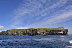 Isle of Noss. The south west cliff face of the isle of Noss, a National Nature Reserve, from the sea, Shetland Isles, Scotland stock images