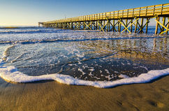 Isle of Palms Pier, Atlantic Ocean, South Carolina. Warm morning light at the Isle of Palms Pier in South Carolina along the Atlantic shore Royalty Free Stock Images