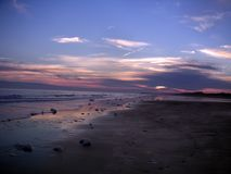 Isle of palms South Carolina sunset through the clouds with purple skies.  stock photography