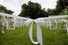 Isle runner ribbon at an outdoor wedding Stock Photography