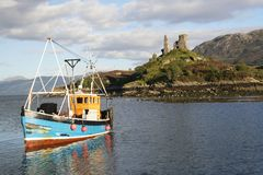 Isle of Skye. A fishing boat returning to harbour after a successful day Royalty Free Stock Images