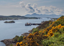 Isle of Skye Bridge, Scottish Highlands. Landscape of the Scottish Highlands with the Isle of Skye Bridge on the island of Eilean Ban, Lochalsh in the distance royalty free stock image