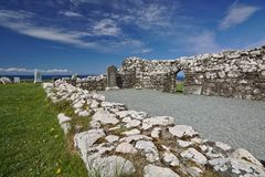 Isle of Skye, Scotland - Ruin of Trumpan Church with headstones and the ocean in the background. Isle of Skye, Scotland - Ruin of Trumpan Church with headstones royalty free stock images