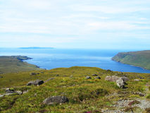 Isle of Skye. The strikingly blue sky and sea seem to be melting together in this view from the hills of the Isle of Skye Royalty Free Stock Photos