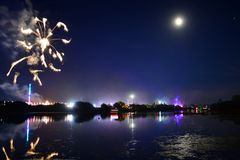 Isle of Wight Festival Fireworks. Fireworks, lights and a near full `strawberry` moon reflect off the River Medina on the last night of the 2018 Isle of Wight Royalty Free Stock Photo