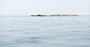 Islet and calm sea Stock Photo