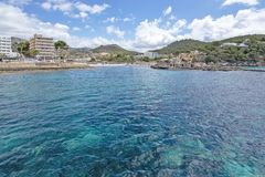 Islet turquoise water sandy beach sea Camp de Mar Mallorca royalty free stock photo