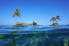 Islets with coconut tree viewed from sea surface Royalty Free Stock Images
