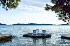 The Vodice cityscape. Islets for relaxing on the beach Vodice, Croatia royalty free stock images
