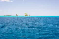 Islets among the Togian Islands Stock Photos