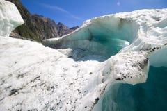 Isliten vik Franz Josef Glacier på en solig dag arkivfoton