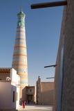 Islom Hoja Minaret in Khiva. View of Islom Hoja Minaret from streets of Itchan Kala  - old centre of Khiva, Khorezm, Republic of Karakalpakstan, Uzbekistan Stock Images
