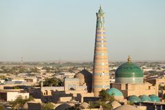 Islom Hoja Minaret and Madrasa in Khiva. Evening view of Islom Hoja Minaret and Madrasa in Itchan Kala  - old centre of Khiva, Khorezm, Republic of Stock Photography