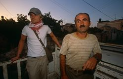 An ISM volunteer and a Palestinian man. Royalty Free Stock Photography