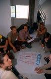 ISM volunteers in Palestine. ISM volunteers sat on the floor brainstorming in Palestine royalty free stock images