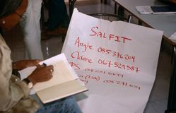 ISM volunteers in Palestine. A volunteer is writing down phone numbers in a notebook stock photo