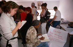 ISM volunteers in Palestine. A couple of volunteers are writing down phone numbers stock photography