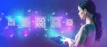 ISO 9001 with woman using a tablet. ISO 9001 with business woman using a tablet computer royalty free stock photo