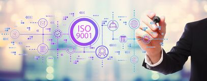ISO 9001 with businessman. On blurred abstract background stock photo