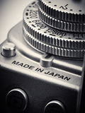 ISO control dial on SLR japan camera. ISO control dial on SLR camera closeup Royalty Free Stock Image