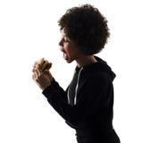 ISO joven de la silueta de la sombra de la hamburguesa de la consumición de la mujer de la muchacha del adolescente Fotografía de archivo
