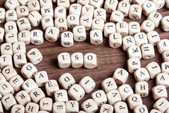 ISO, letter dices word. Word ISO in letters on cube dices on table Stock Images