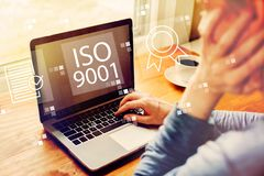 ISO 9001 with man using a laptop. Computer royalty free stock images