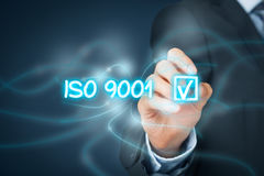 ISO 9001 quality management system. ISO 9001 - quality management system. Businessman click on button with ISO 9001 - certification concept royalty free stock photo