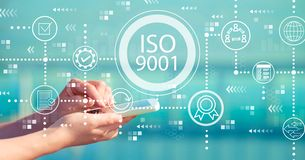 ISO 9001 with smartphone. ISO 9001 with person holding a white smartphone royalty free stock images
