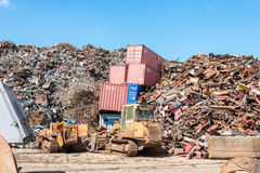 ISO standard containers swallowed by the scrap metal Royalty Free Stock Photo