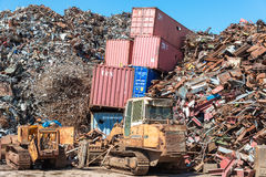 ISO standard containers swallowed by the scrap metal Stock Images
