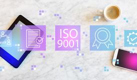 ISO 9001 with tablet and phone. ISO 9001 with a tablet computer and smart phone stock photography