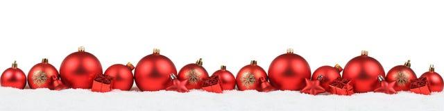 Iso vermelho do inverno da neve do fundo da decoração da bandeira das bolas do Natal Fotos de Stock