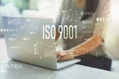 ISO 9001 with woman using laptop. ISO 9001 with woman using her laptop in her home office royalty free stock photos