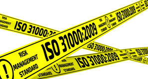 ISO 31000:2009. Yellow warning tapes. Yellow warning tapes with inscription `ISO 31000:2009` risk management standard. Isolated. 3D Illustration Royalty Free Stock Images