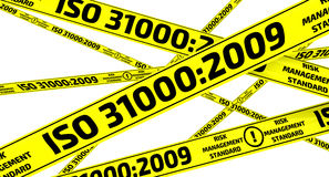 ISO 31000:2009. Yellow warning tapes. Yellow warning tapes with inscription `ISO 31000:2009` risk management standard. Isolated. 3D Illustration Royalty Free Stock Image