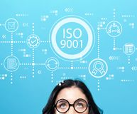 ISO 9001 with young woman. Wearing eye glasses stock photo