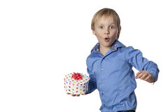 Small boy with funny face and present Royalty Free Stock Photos