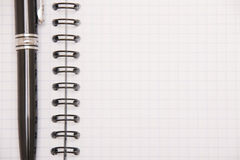 Isoalted note-pad. Isolated note-pad with black pen Royalty Free Stock Photos