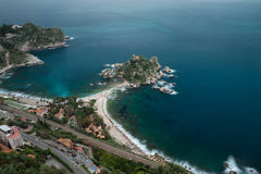 Isola Bella on the beautiful coast of Taormina. A panoramic view of the coast of Taormina with Isola Bella in the center of the photo and the nice effect of the Stock Photos