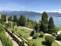 Isola Bella Gardens with Trees and Flowers and Lake View. Beautiful park on the island of Isola Bella in Lago Maggiore, Italy,Lombardy ,Northern Italy stock photo