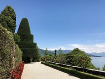 Isola Bella Gardens with Trees and Flowers and Lake View. Beautiful park on the island of Isola Bella in Lago Maggiore, Italy,Lombardy ,Northern Italy royalty free stock photography