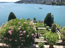 Isola Bella Gardens with Trees and Flowers and Lake View. Beautiful park on the island of Isola Bella in Lago Maggiore, Italy,Lombardy ,Northern Italy royalty free stock photos