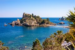 The Isola Bella island with the beach, excursion boats and bathe. Rs in Taormina, Italy Royalty Free Stock Images